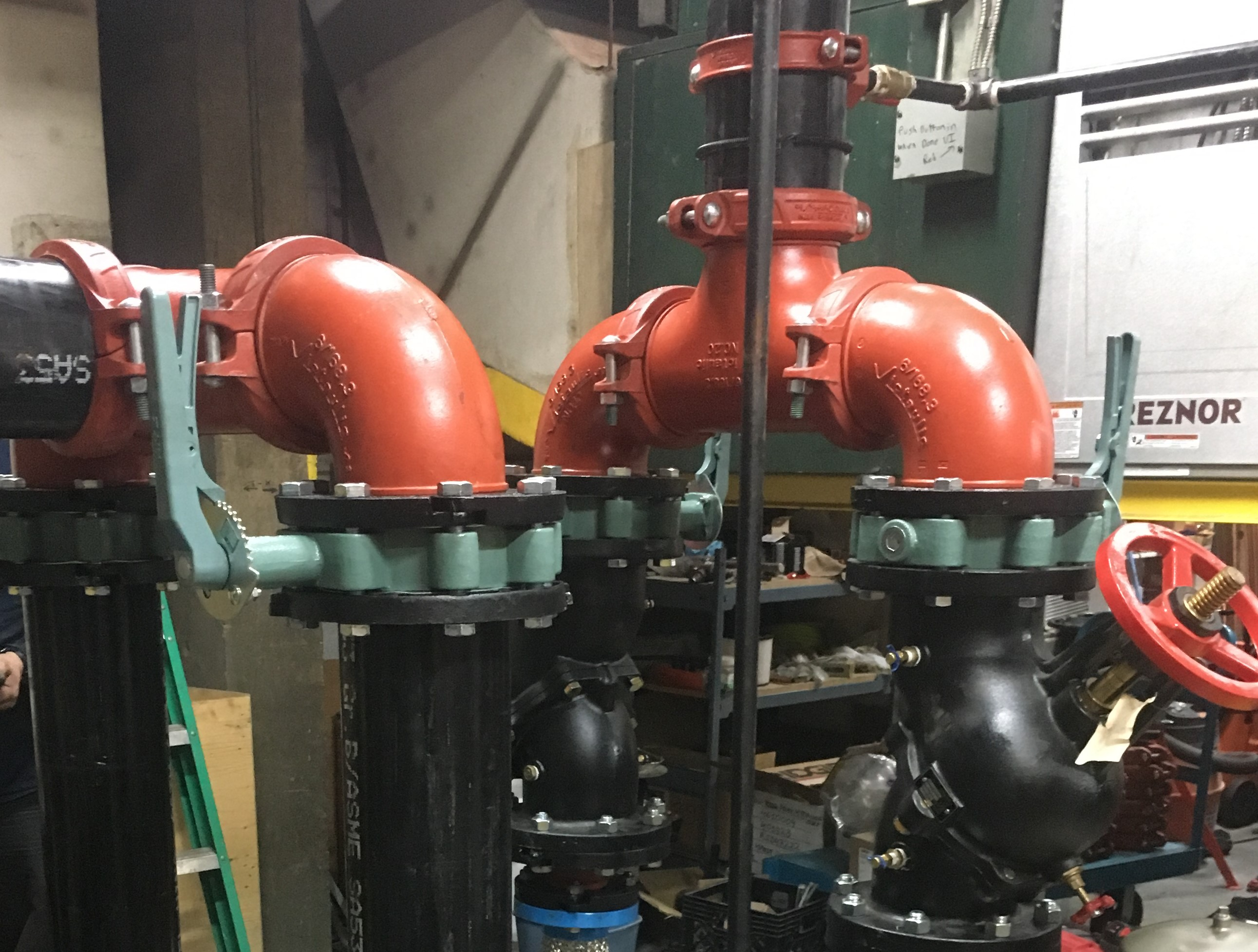 Red and black pipes in industrial room