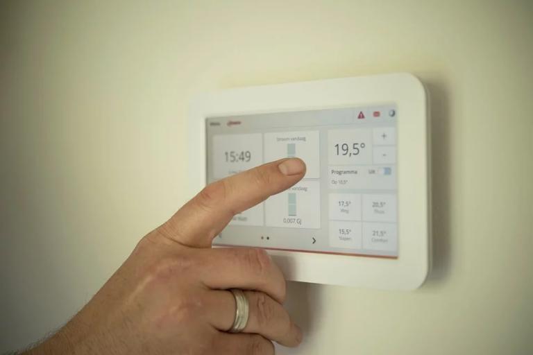 Digital thermostat on cream wall